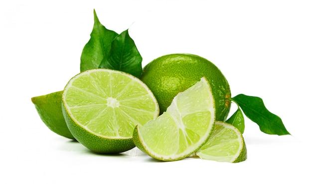 Chopped lime fruit isolated on white