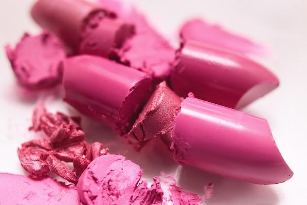 Chopped pink lipstick closeup