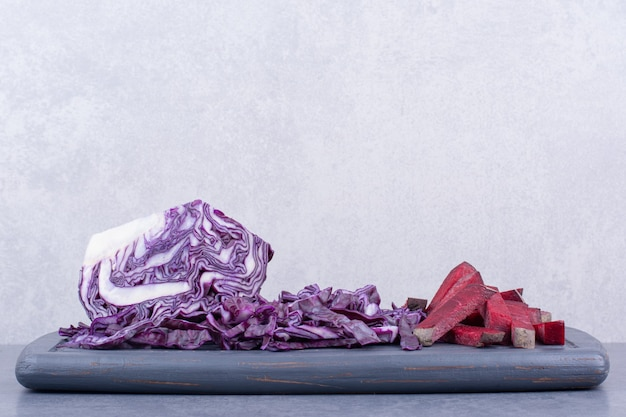 Chopped purple cabbage on a wooden platter.
