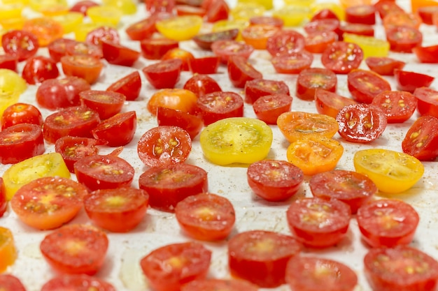 Chopped scattered red and yellow tomatoes on a tray cooking ingredient.