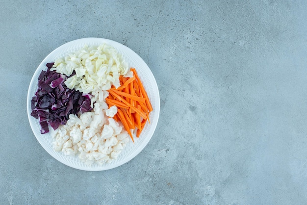 Chopped vegetable salad in a white platter.