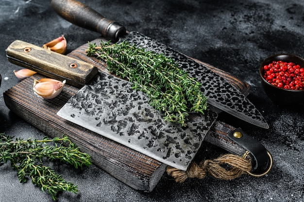 Chopping board and meat cleaver with knife.