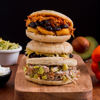 Chopping board with assortment of arepas