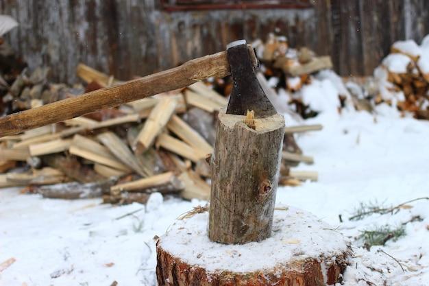 Chopping wood in winter closeup