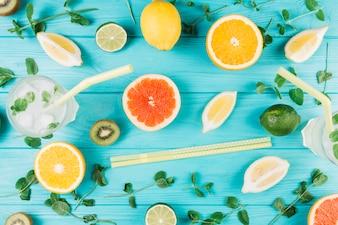 Chopsticks and citruses near drinks