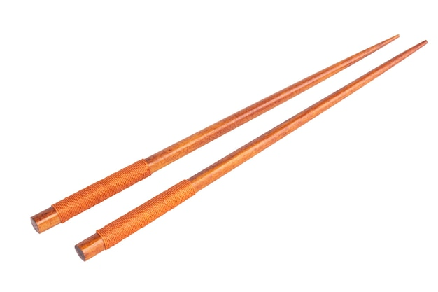 白い背景に分離された箸。
