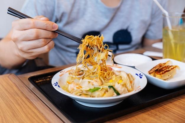 Chopsticks pinching champon ramen