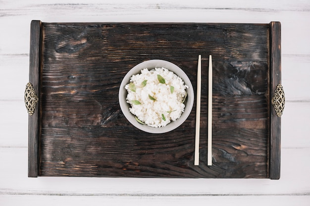 Chopsticks and rice on tray