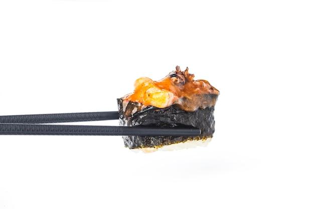 Chopsticks sandwiched with japanese sushi