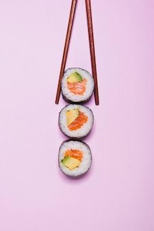 Chopsticks taking sushi
