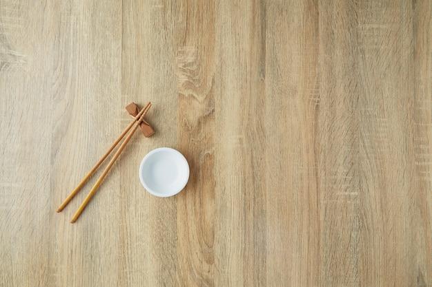Chopsticks and white bowl