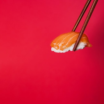 Chopsticks with sushi