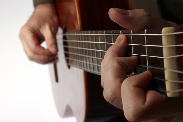 In the chord playing classical guitar closeup