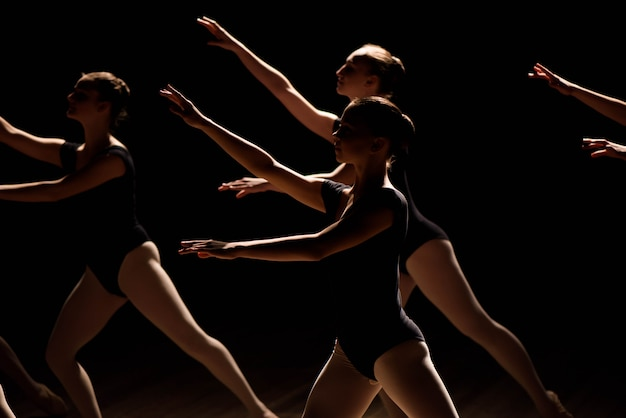 A choreographed dance of a group of graceful pretty young ballerinas