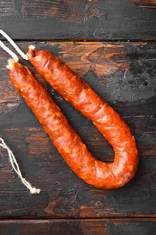 Chorizo sausage on dark wood table.