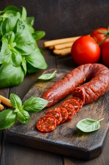 Chorizo sausage. spanish traditional chorizo sausage with fresh herbs and tomatoes.