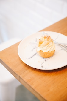 Choux cream on wooden table