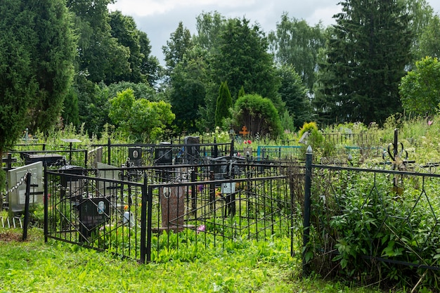 Christian cemetery with green trees. moscow, russia, 07-04-2021.
