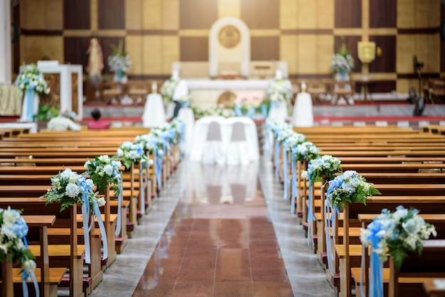Christian church interior with wedding flower decoration
