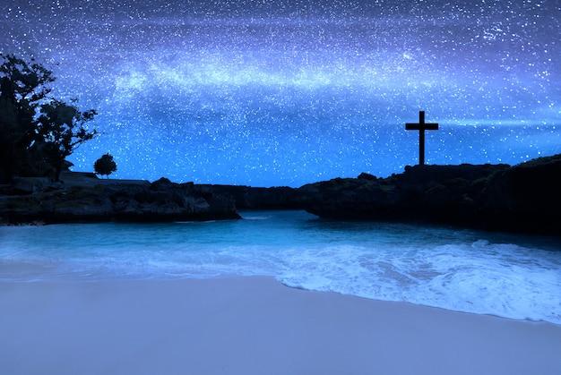 Christian cross on the beach