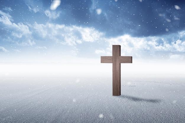 Христианский крест на снегу с фоном снегопада