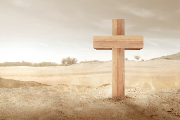 Christian cross on the sand