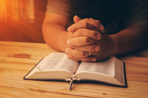 Christian hand while praying and worship for christian religion