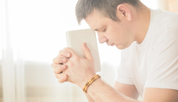 The christian holds the bible in his hands. the concept of faith, spirituality and religion. prayer for prayer