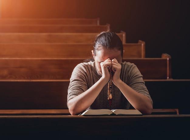 Christian woman praying in church.