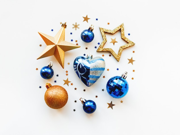 Christmas and  2020  with decorations, shaped as a circle. golden and blue balls, stars, confetti and heart.