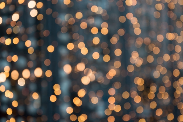 Christmas abstract . blurred golden garland blur bokeh, defocused pattern.
