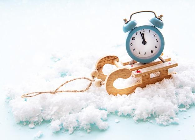 Christmas alarm clock on a toys sled