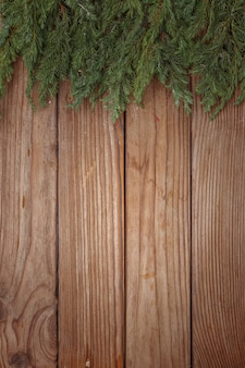 Christmas arrangement of tree branches on wooden background. top view. copy space.