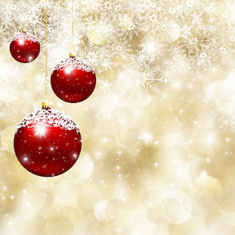 Christmas background of  baubles on falling snowflakes