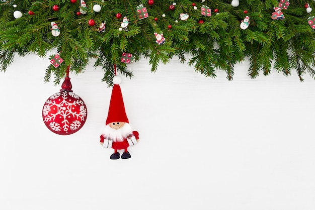 Christmas background. christmas decoration with santa on white wooden background. copy spa