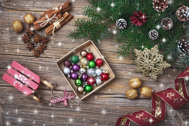 Christmas background. christmas fir tree branch with decoration. copy space, top view, toned