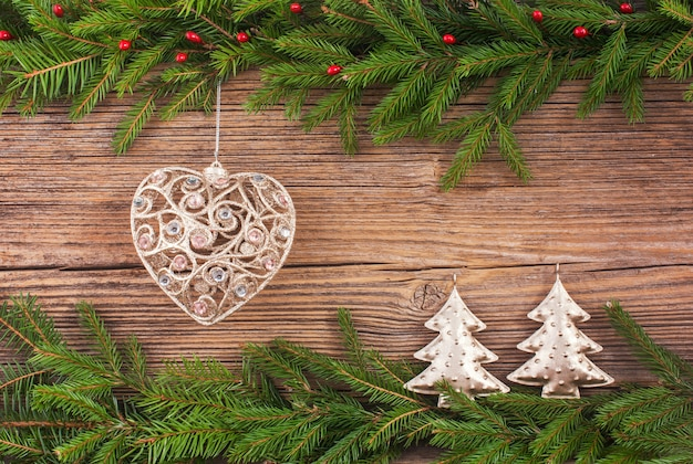 Christmas background. christmas fir tree, christmas tree toy, gifts on old wooden board background with copy space. toned