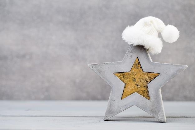 Christmas background. christmas star and santa hat. greeting card.