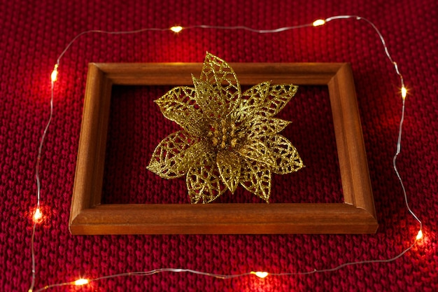 Christmas background christmas toys frame and garland lying on the knitted texture of a sweater