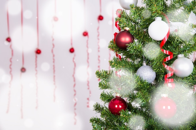 Christmas background - close up of christmas tree with white and red balls