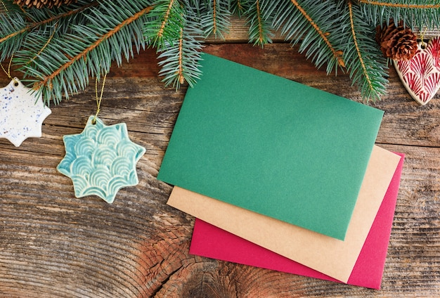 Christmas background concept. multicolored cards. christmas tree branches with cones.