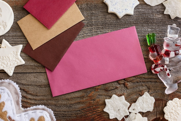 Christmas background concept. multicolored envelopes. christmas tree branches with cones.