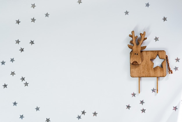 Christmas background. decorative wooden deer on stars . copyspace, top view
