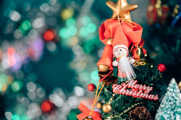 Christmas background of defocused lights with decorated tree