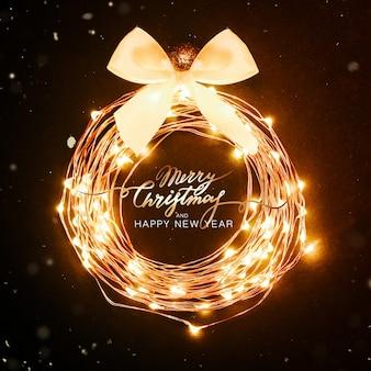 Рождественский фон. светящийся круг из гирлянды в виде елочной игрушки на черном фоне с блестками. праздничная концепция дизайна надписи