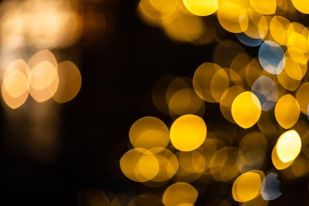 Рождественский фон. золотой праздник абстрактный блеск расфокусированным фон. размытое боке