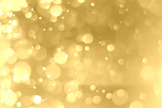 Christmas background and happy new year. circular golden bokeh background. abstract background.