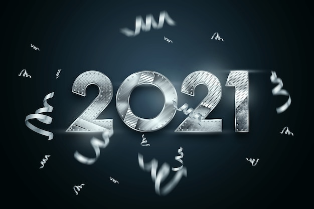 Christmas background lettering 2021 with metal numbers on a dark background.