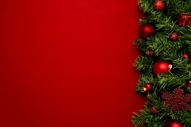 Christmas background made with garlands on a red background
