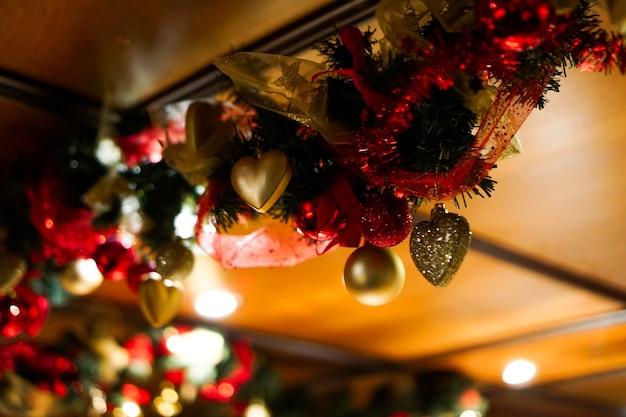 Christmas background, new year heart shaped decoration. blinking garland. beautiful winter holiday backdrop, glowing garlands